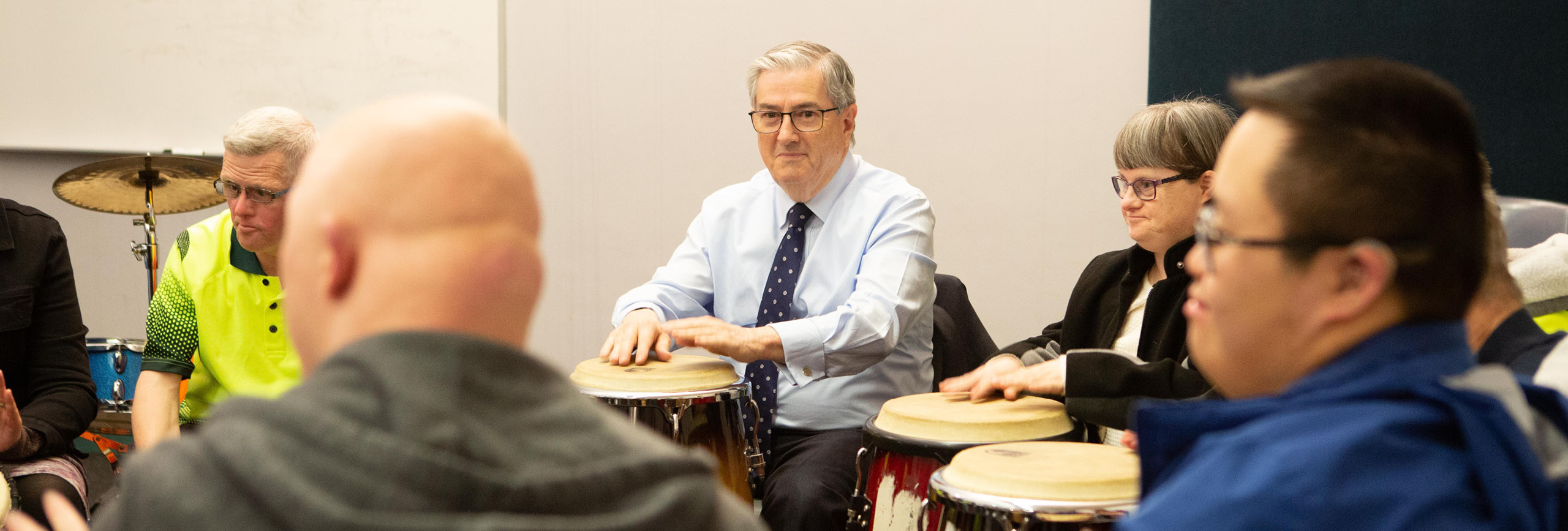 Mayor joins music therapy drumming class