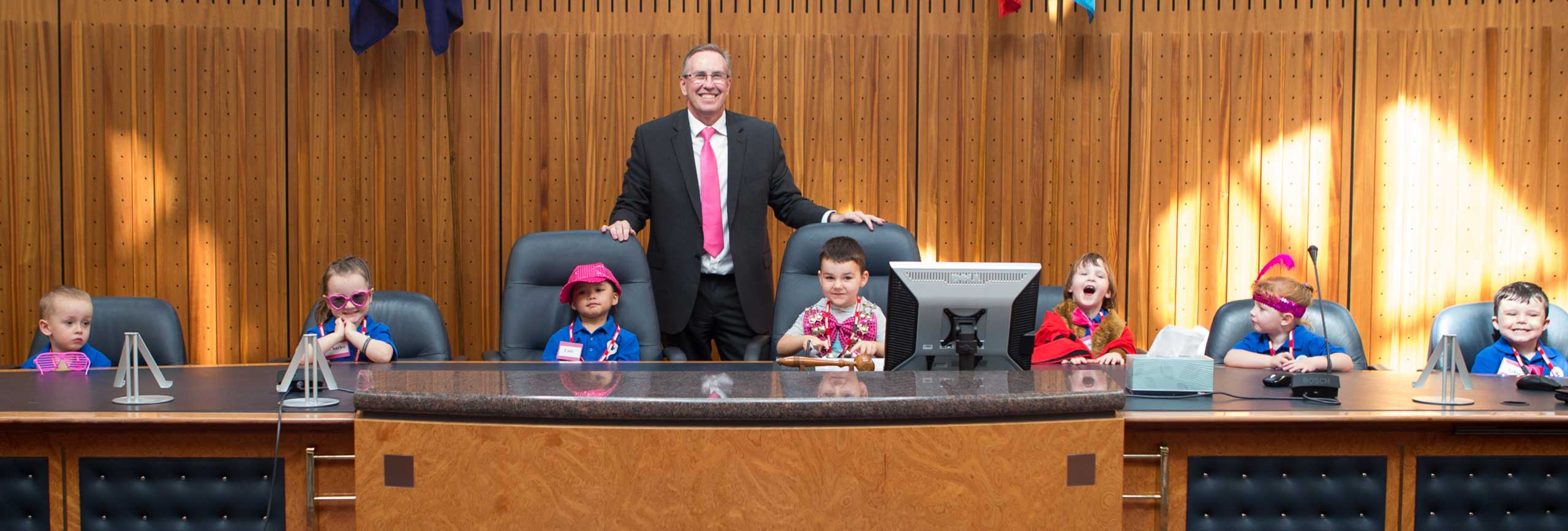 General Manager Warwick Winn (centre) in the Council Chambers with the children from Cook Parade Children's Centre, St Clair