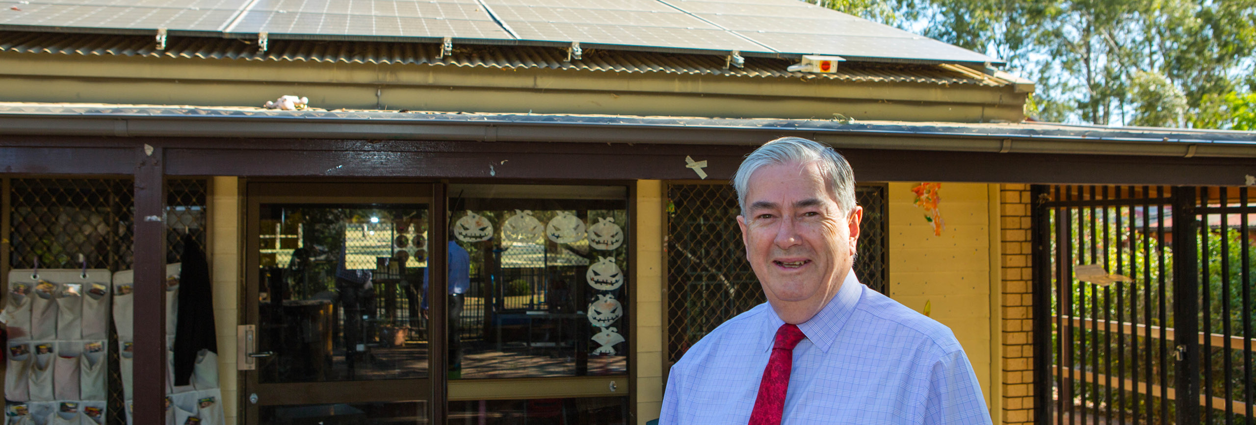 Mayor Cr Ross Fowler OAM shows off solar panels