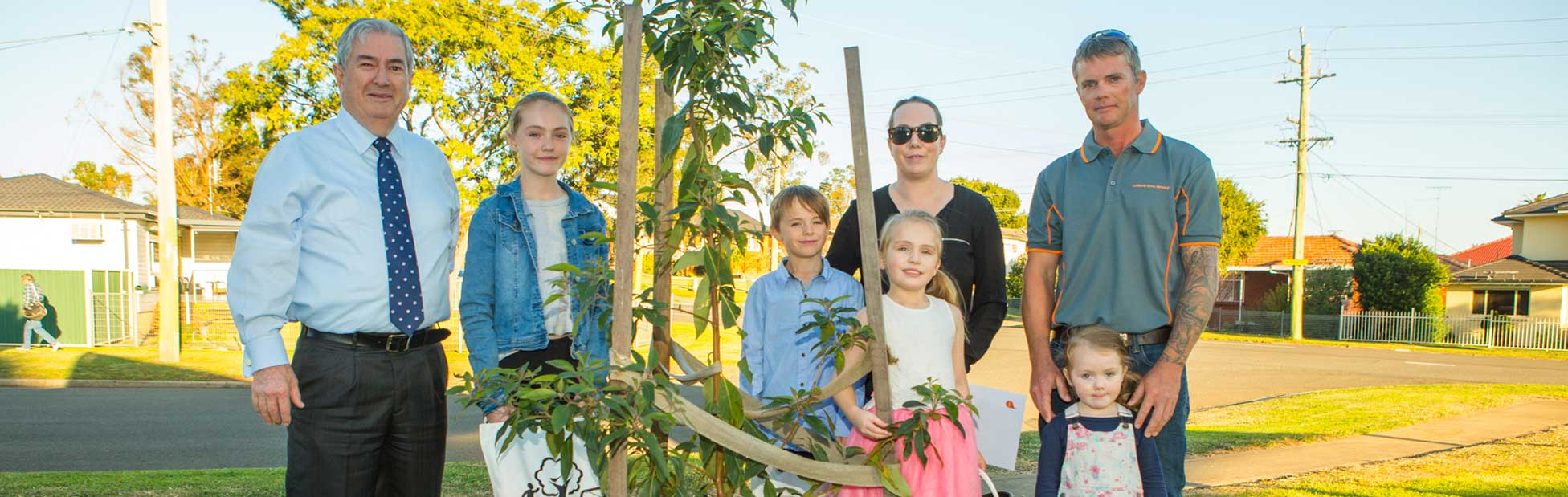 Penrith Mayor Ross Fowler OAM with the Moy family of St Marys who are excited about receiving their street tree.