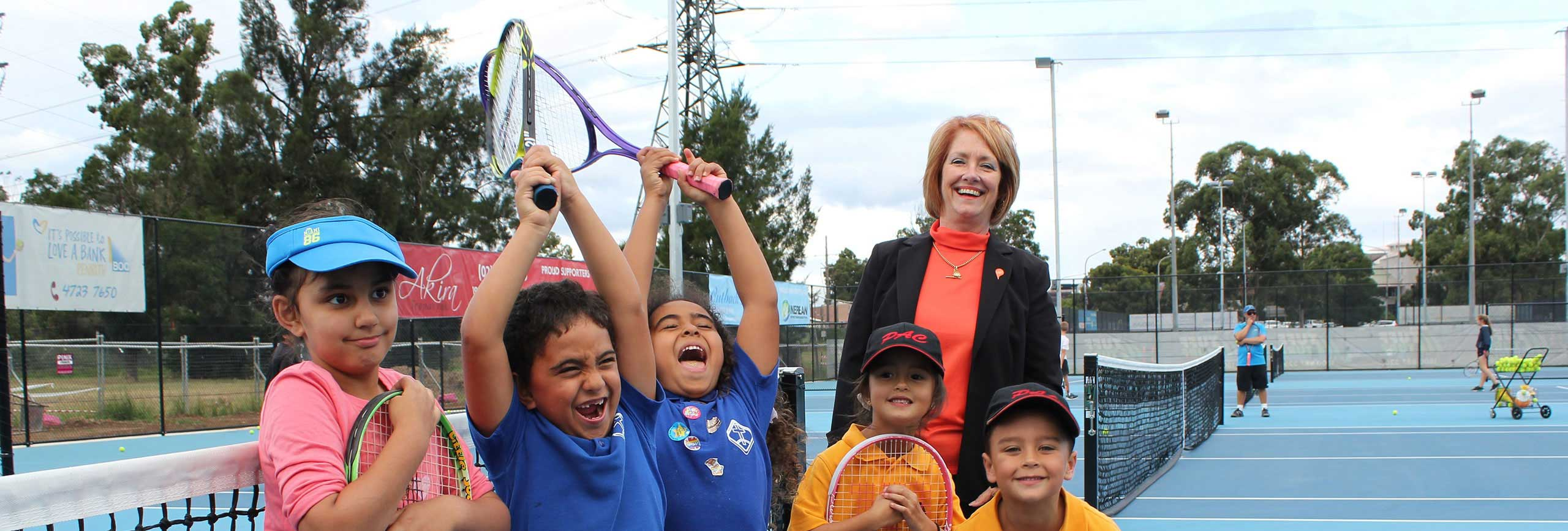 Penrith Mayor Cr Karen McKeown with children on Woodriff Gardens Tennis courts.